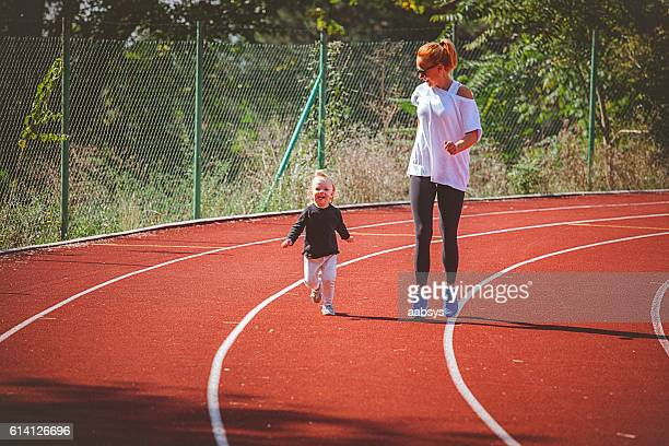 Me and my mom sprinting on the running track.