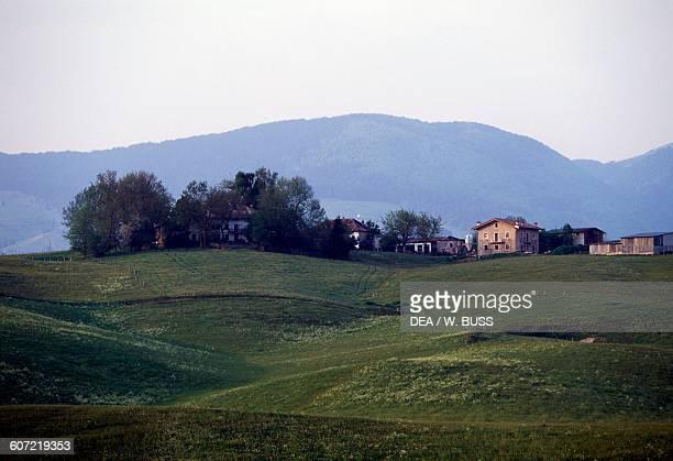 Meadow and a village Sette Comuni or Asiago Plateau Veneto Italy