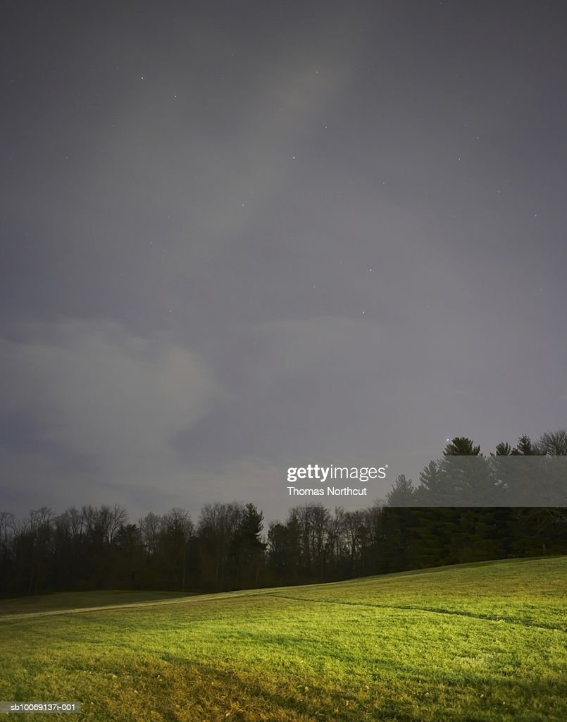 Meadow, forest and moody sky : Stockfoto