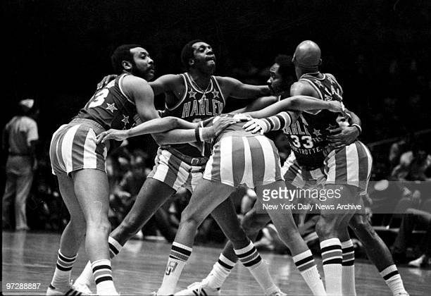 Meadowlark Lemon and his teammates huddle during game to plan more deviltry