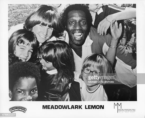 Meadowlark Lemon of the Harlem Globetrotters poses for a portrait with children circa 1970's Lemon played with the Globetrotters from 19551980