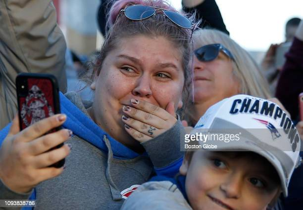 Meag Camara of Acushnet becomes emotional as she watches the New England Patriots return from Atlanta to Gillette Stadium in Foxborough MA following...