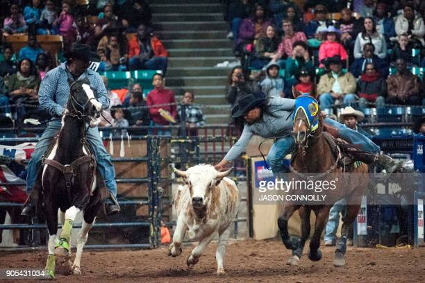 Meagan Byrd competes in the Ladies Steer Undercoating competition during the MLK Jr African American Heritage Rodeo at the National Western Stock...