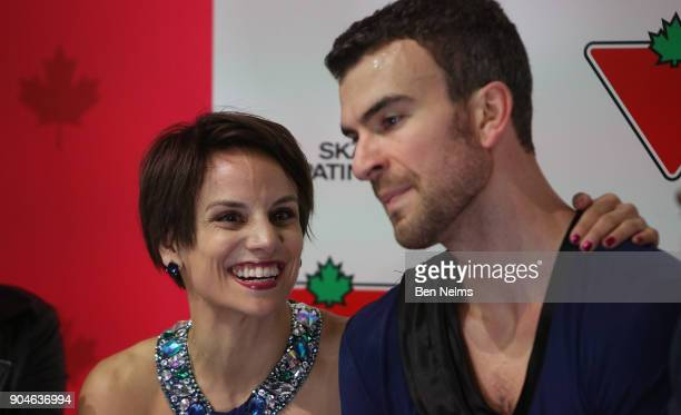Meagan Duhamel and Eric Radford of Canada await their score after competing in the free pair program during the 2018 Canadian Tire National Skating...