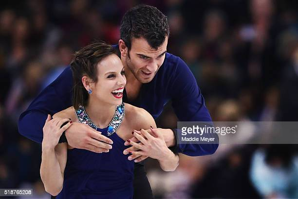 Meagan Duhamel and Eric Radford of Canada celebrate after completing their routine in the Pairs Free Skate on Day 6 of the ISU World Figure Skating...