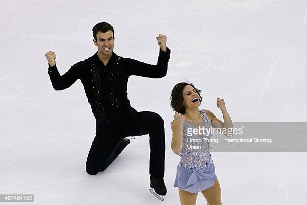 Meagan Duhamel and Eric Radford of Canada celebrate after performing in the Pairs Short Program on day one of the 2015 ISU World Figure Skating...