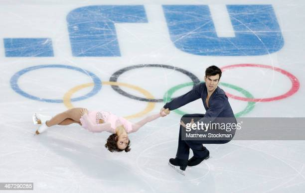 Meagan Duhamel and Eric Radford of Canada compete in the Figure Skating Pairs Short Program during the Sochi 2014 Winter Olympics at Iceberg Skating...