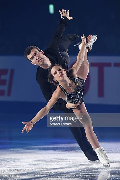 Meagan Duhamel and Eric Radford of Canada perform their routine in the exhibition during day three of ISU Grand Prix of Figure Skating 2014/2015 NHK...