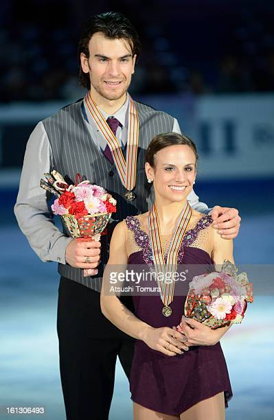 Meagan Duhamel and Eric Radford of Canada pose after the medals ceremony for the pair's competition during day three of the ISU Four Continents...
