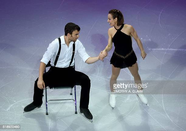 Meagan Duhamel and Eric Radford of Canada skate during the Exhibition of Champions program at the ISU World Figure Skating Championships at TD Garden...