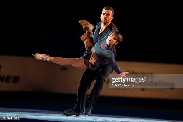 Meagan Duhamel and Eric Radford of Canada skate their exhibition program on at the ISU Grand Prix of Figure Skating's Skate Canada International at...