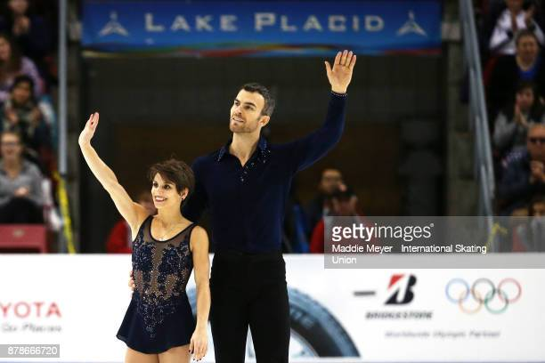 Meagan Duhamel and Eric Radford of Canada wave to fans after their performance during the Pairs Short program on Day 1 of the ISU Grand Prix of...