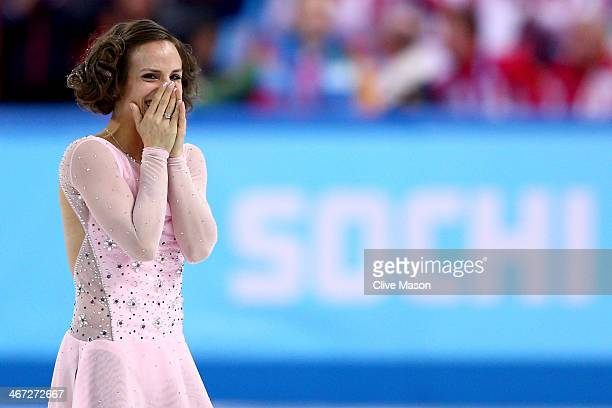 Meagan Duhamel of Canada competes in the Figure Skating Pairs Short Program during the Sochi 2014 Winter Olympics at Iceberg Skating Palace on...