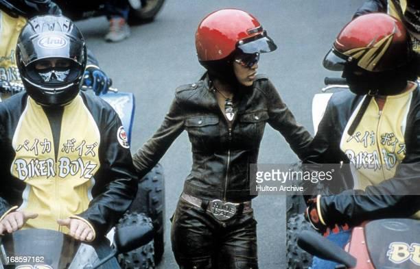 Meagan Good in a red motorcycle helmut in a scene from the film 'Biker Boyz' 2003