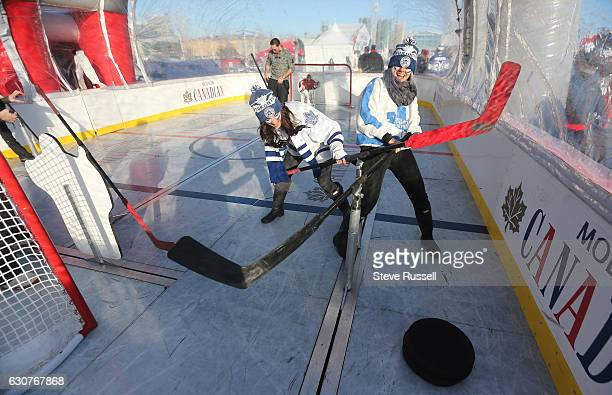 TORONTO ON JANUARY 1 Meagan Schers and Courtney Kennedy battle for position as they play bubble hockey as the Toronto Maple Leafs play the Detroit...