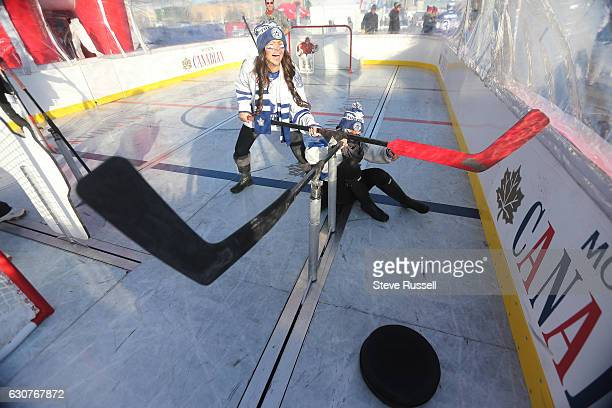 TORONTO ON JANUARY 1 Meagan Schers laughs as her friend Courtney Kennedy fell as they battled for the puck as they play bubble hockey as the Toronto...