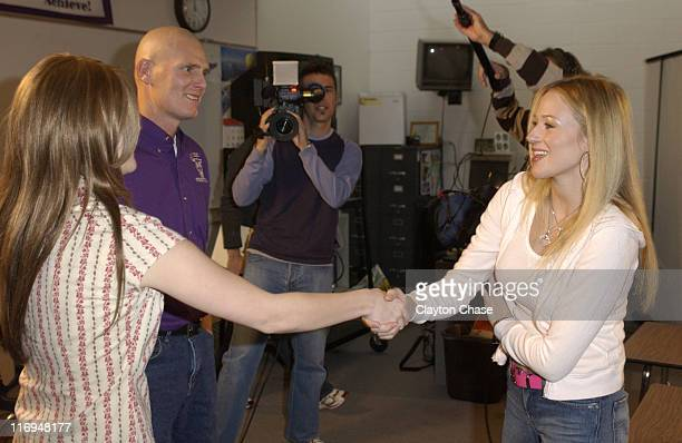 Meagan Thompson meets Jewel during Jewel special appearance and Channel One benefit concert at Lehi High School in Lehi Utah United States