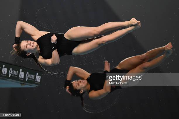 Meaghan Benfeito and Caeli McKay of Canada compete during the 10m Synchro Platform Women's Final on day one of the FINA Diving World Cup Sagamihara...