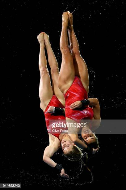 Meaghan Benfeito and Caeli Mckay of Canada compete in the Women's Synchronised 10m Platform Diving Final on day seven of the Gold Coast 2018...