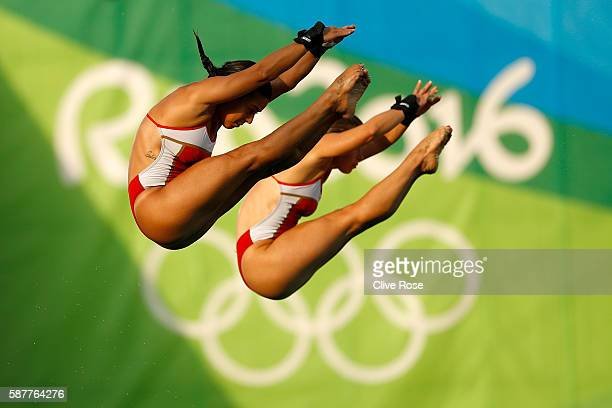 Meaghan Benfeito and Roseline Filion of Canada compete in the Women's Diving Synchronised 10m Platform Final on Day 4 of the Rio 2016 Olympic Games...