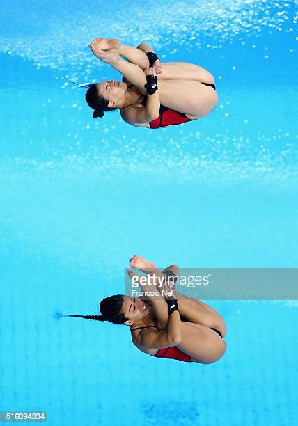 Meaghan Benfeito and Roseline Filion of Canada dives in the Women's 10m Synchro Platform Final during day one of the FINA/NVC Diving World Series...