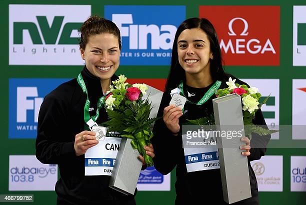 Meaghan Benfeito and Roseline Filion of Canada pose with their silver medals after the Women's 10m Synchro Platform Final during day one of the...