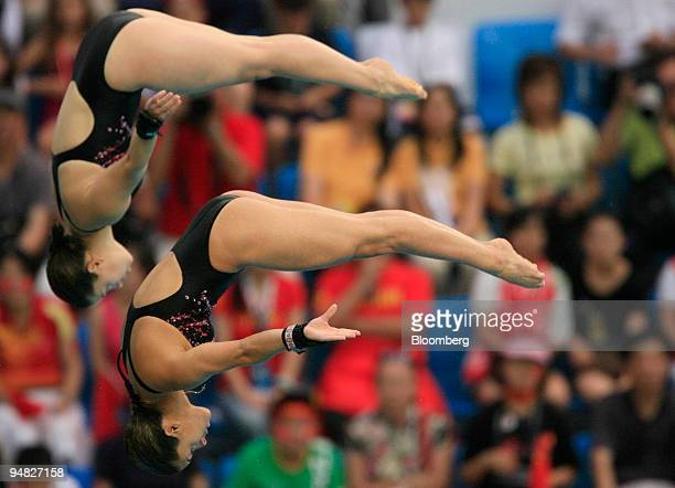 Meaghan Benfeito bottom and Roseline Filion both of Canada hold a pike position in the women's 10meter synchronized diving event during day four of...