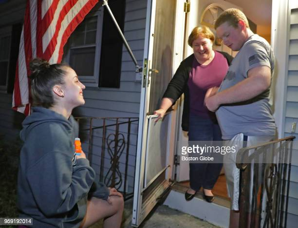 Meaghan Downing a senior at Medway High School stands on the doorstep of her target in the 'Senior Soak' competition Billy Furdan and his mother Anne...
