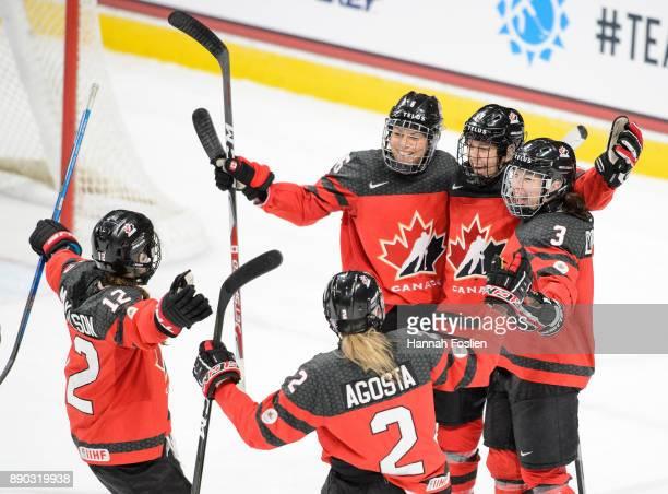 LR0 Meaghan Mikkelson Meghan Agosta Rebecca Johnston Brianne Jenner and Jocelyne Larocque of Canada celebrate winning the game against the United...