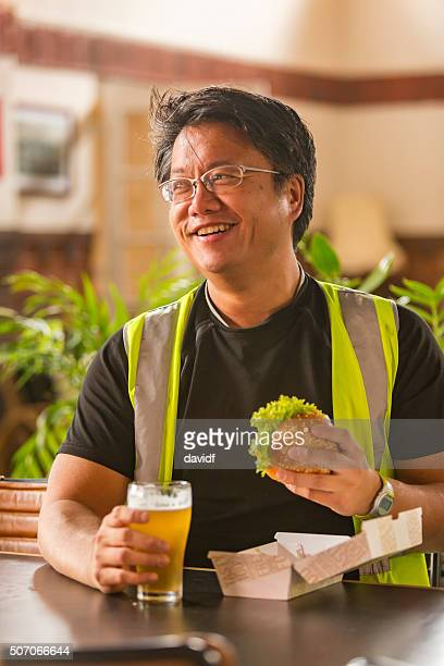 Meal Break For a Workman in High Visibility Clothes