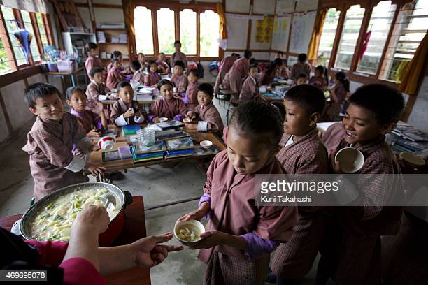 Meal is distributed to students in the classroom at Zilukha Lower Secondary School in Thimphu Bhutan on August 13 2014 It's said that about 10% of...