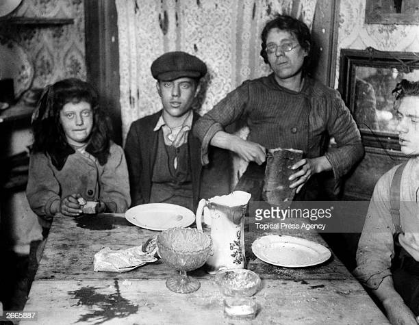 A meal of bread for a povertystricken family in Shadwell East London