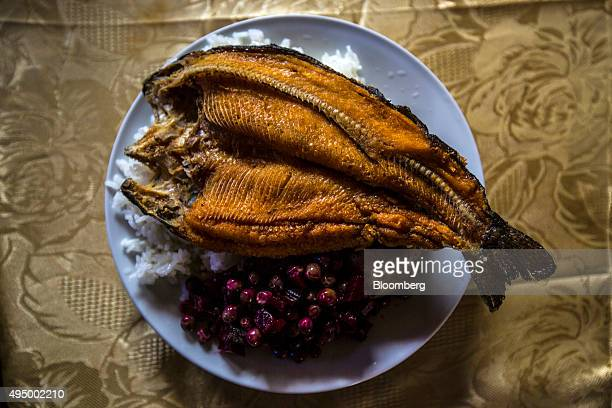 A meal of deep fried trout rice peas and beets is displayed for a photograph at a local community restaurant sponsored by the operators of the...