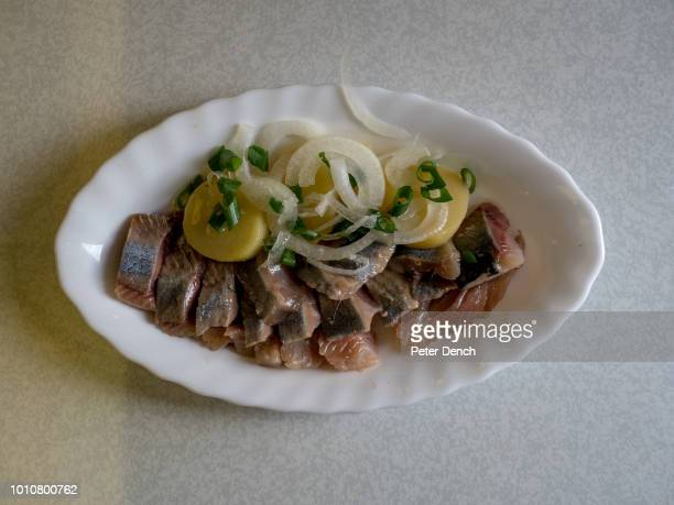 A meal of pickled herring boiled potatoes and onion served in the restaurant car on the TransSiberian Railway from MoscowVladivostok Spanning a...
