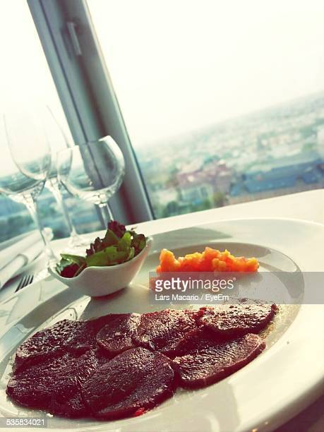 Meal On Plate Against Window