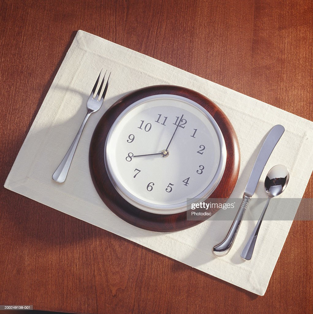 Meal place setting with clock as plate : Stock Photo
