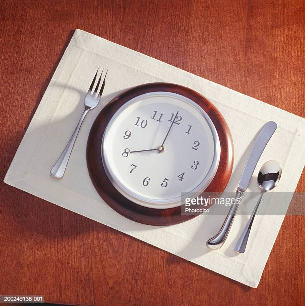 Meal place setting with clock as plate