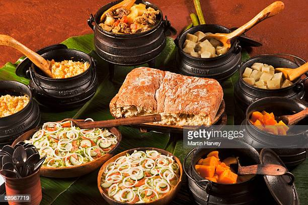 Meal served in traditional 3-legged cast iron pots