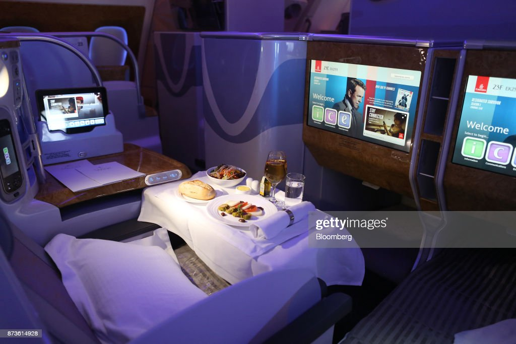 A meal sits on a table in the business class cabin of an Airbus SE A380-800 passenger aircraft, operated by Emirates Airlines, during the 15th Dubai Air Show at Dubai World Central (DWC) in Dubai, United Arab Emirates, on Monday, Nov. 13, 2017. The biennial Dubai expo is an important venue for manufacturers to secure deals for their biggest and most expensive jetliners. Photographer: Natalie Naccache/Bloomberg via Getty Images