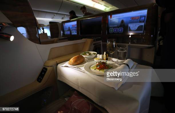 A meal sits on a travellers tray in the business class cabin on board a Boeing Co777300ER passenger jetliner operated by Emirates Airline at London...