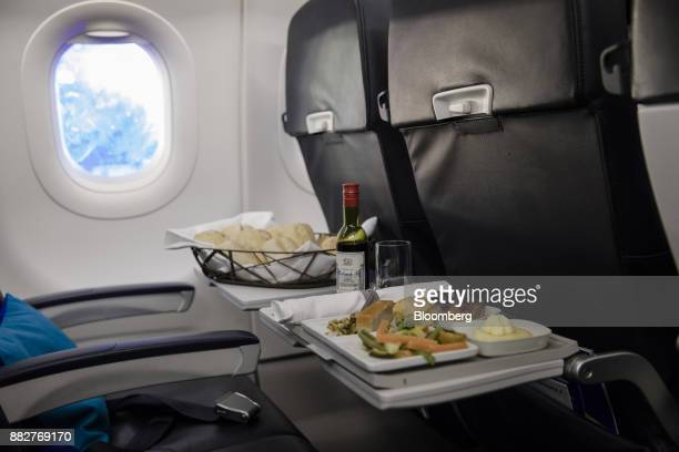 A meal sits on business class seating foldout tables on board a Joon passenger jet the new lowcost carrier operated by Air FranceKLM Group at Charles...