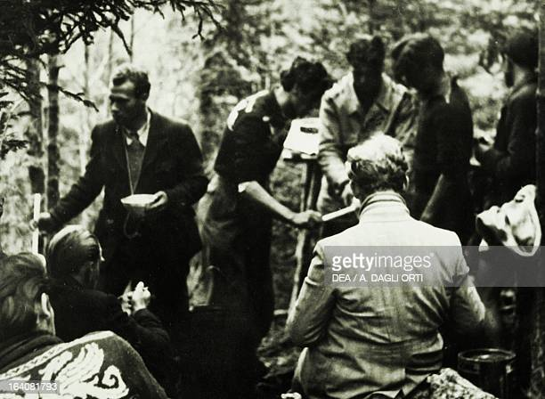 Meal time for a partisan unit in the underbrush of the woods on the Plateau of the Seven Communities World War II Resistance Italy 20th century...