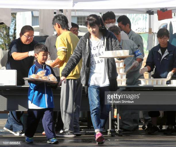 Meals are offered at an evacuation center on September 11 2018 in Atsuma Hokkaido Japan A male resident in Atsuma who was the last reported missing...