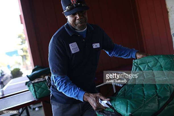 Meals On Wheels of San Francisco driver Ira Fuller prepares to load meals into a van before making deliveries on February 27 2013 in San Francisco...