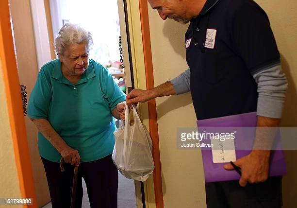 Meals On Wheels of San Francisco driver Jim Fleming delivers meals to Yvonne Jarkowski on February 27 2013 in San Francisco California Programs for...