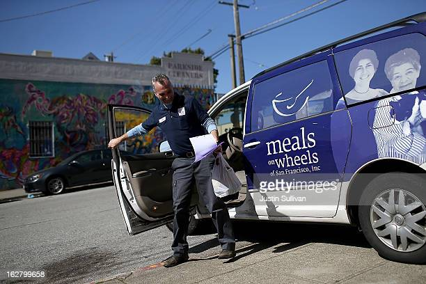 Meals On Wheels of San Francisco driver Jim Fleming prepares to deliver meals on February 27 2013 in San Francisco California Programs for the poor...