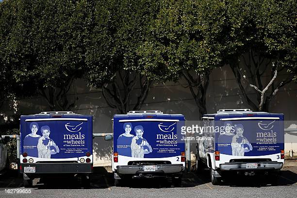 Meals On Wheels of San Francisco trucks sit idle on February 27 2013 in San Francisco California Programs for the poor like Meals On Wheels which...
