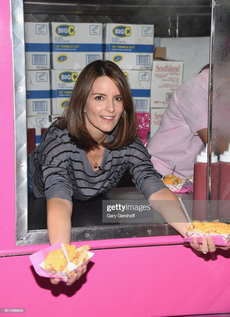 'Mean Girls' bookwriter Tina Fey serves cheese fries to fans in celebration of 'Mean Girls' on Broadway at the August Wilson Theatre on October 3, 2017 in New York City.