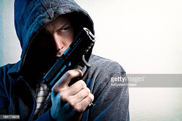mean look - armed robbery stock photos and pictures