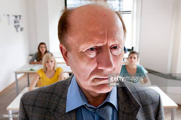 mean looking teacher in classroom - cruel stock pictures, royalty-free photos & images